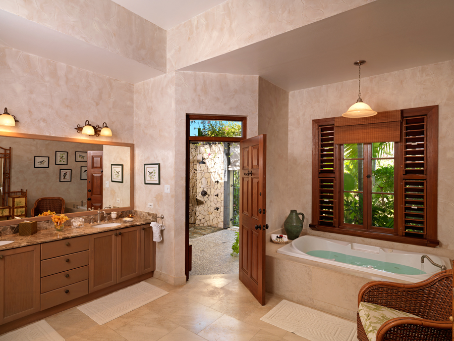 ... that opens to a cut stone open-air Swedish drench shower and massage area ...