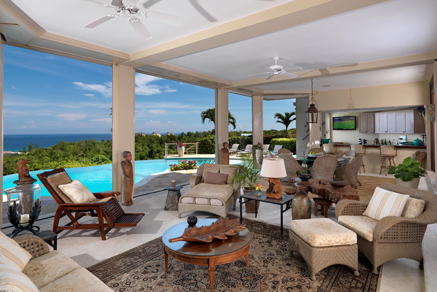Everyone's favorite gathering place is the long furnished poolside verandah ... with full bar and cable television.