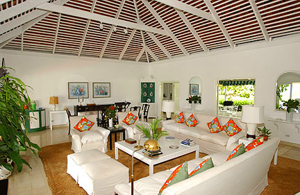 INSIDE THE VILLA The impressive Great Room with high rafter and beam ceiling and grand proportions reflects Old World Caribbean character blended with today's Jamaican style.