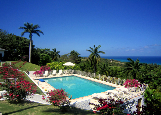 ... overlooking the brilliant bougainvillea, sunny pool and mesmerizing view.