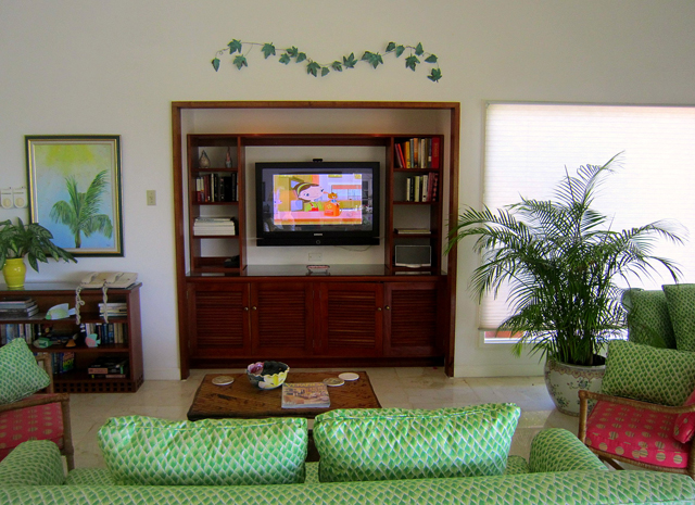 At the other end is a cozy second sitting area by the sound system and flat screen television.