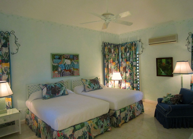 The MASTER BEDROOM features two queensize beds and cable television. Its large bathroom has a bathtub and also a walk-in shower and a separate dressing area.
