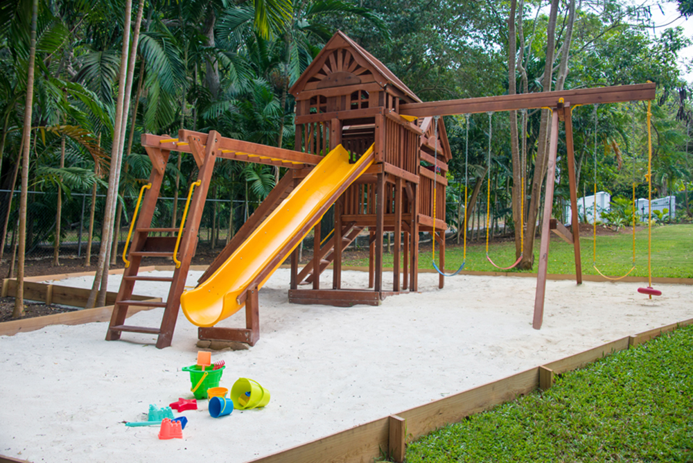 Join the kids on your private playground:  3 swings, climbing wall into the high hut, and 15-foot slide into soft sand. Or play hoops on the  basketball half-court nearby.