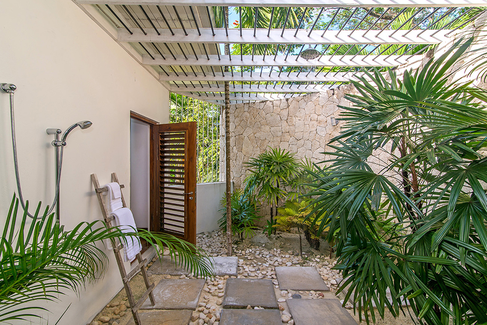 ... and large connecting outdoor shower in a walled palm garden. More than one companion by invitation only!