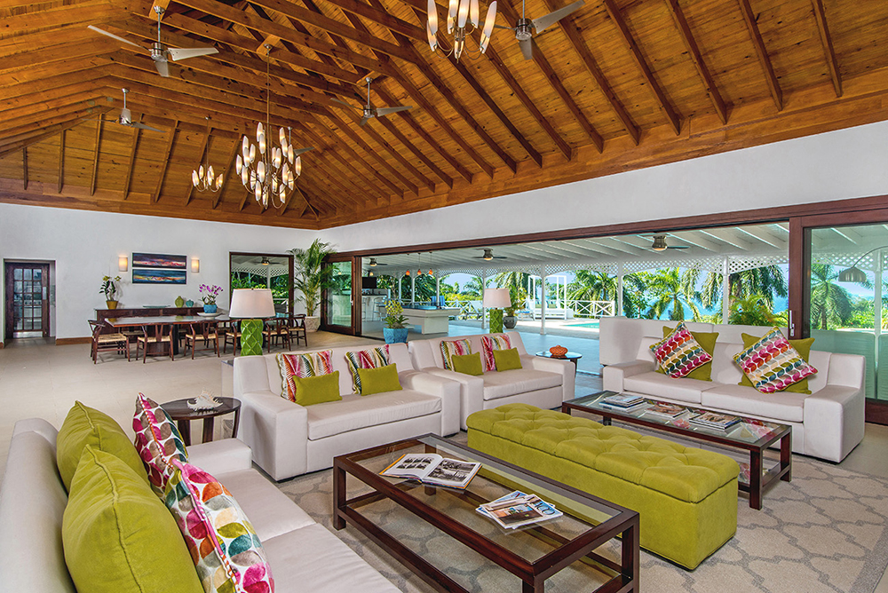 Aptly named, the Great Room features an awesome 50 feet of glass doors that slide behind each other at the edges, opening an entire wall to the verandah and pool.