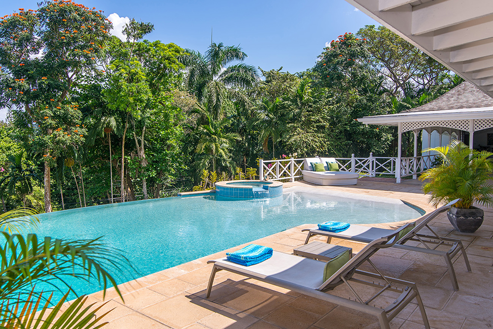 Or choose the private double chaise at the opposite end of the pool. Your villa vacation here will be as active or laid back as you choose.