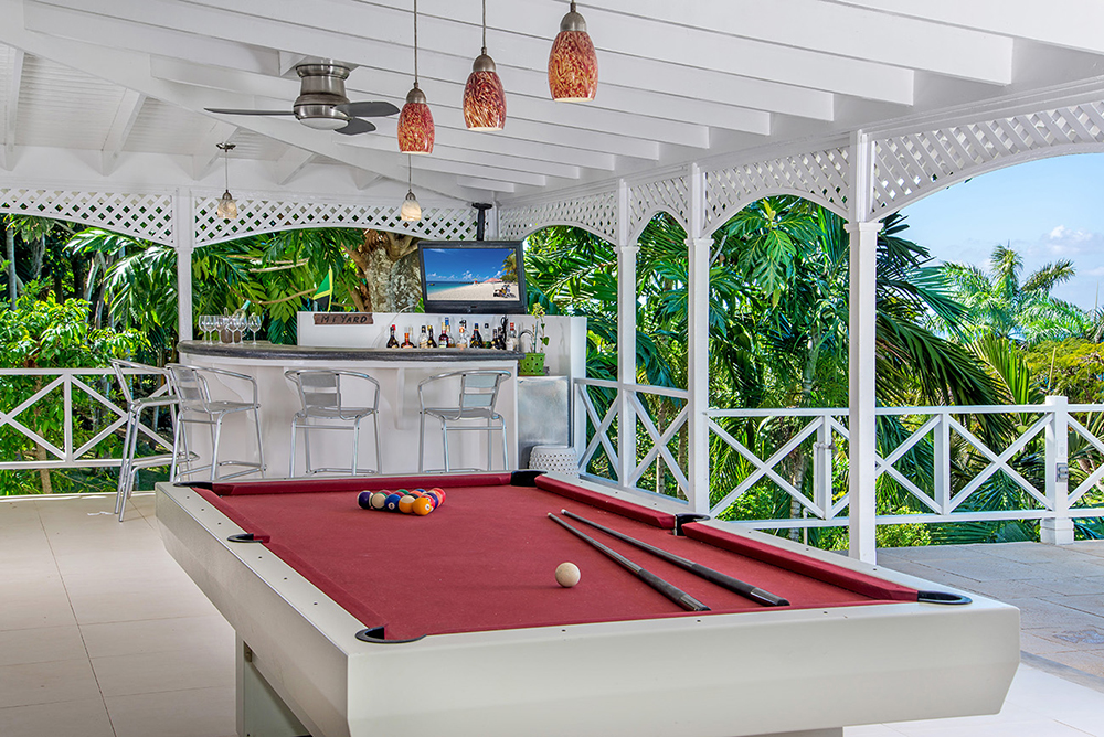 Try your skill on the red felt pool table (converts to a ping pong table!) or sip frozen cocktails at the bar watching a game.