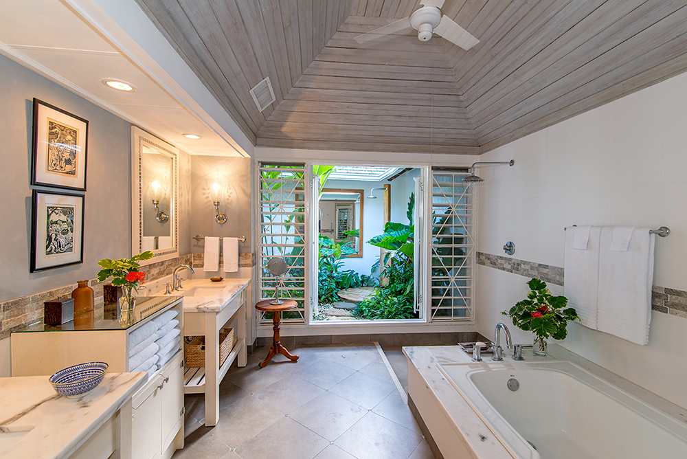 en-suite bathroom with soaking tub, rain shower and outdoor shower