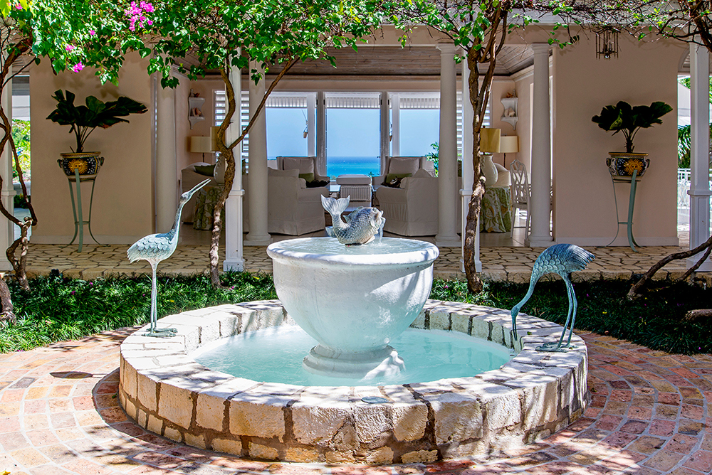 The atrium is the architectural core of the villa:  a leafy centerpiece of fountain and flowers.  A cut stone walkway wraps the atrium and leads to all other upstairs rooms: