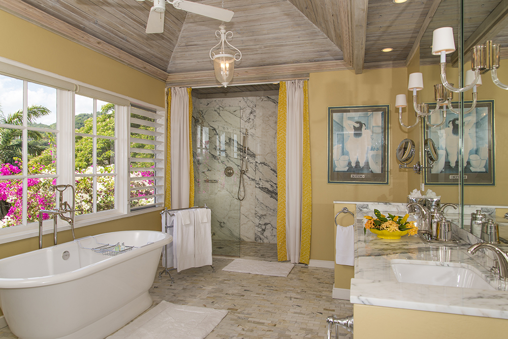 The Master Bath has a deep tub with a view and a marble walk-in shower.  Both bedroom and bathroom are air conditioned.