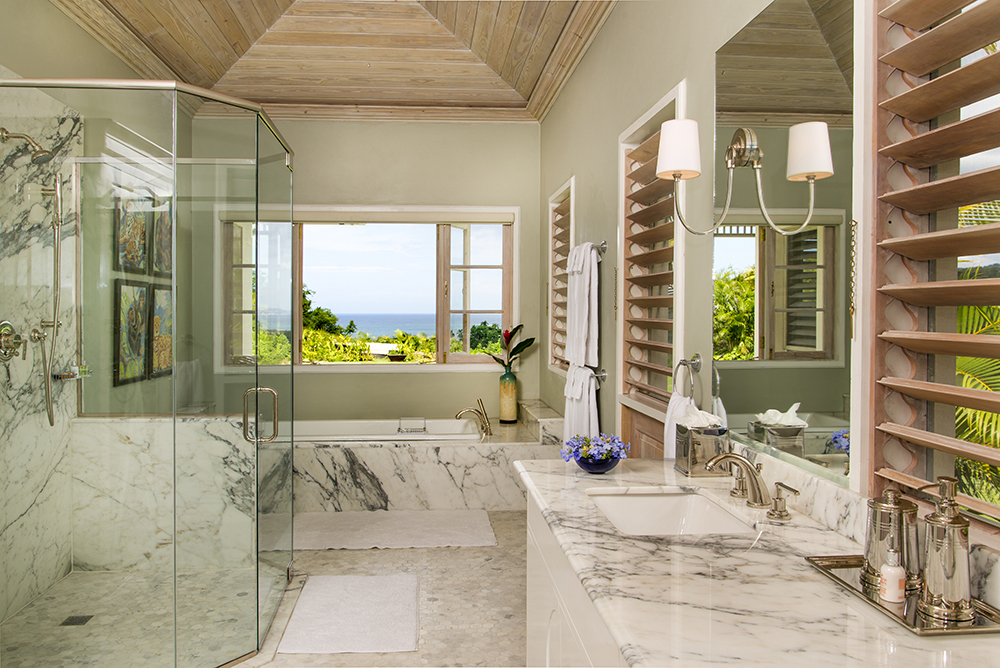 Here is a true Room with a View.  The marble-clad Master Bathroom tub and glass-enclosed shower-for-two offer views clear to the horizon. Both bedroom and bathroom are air conditioned.