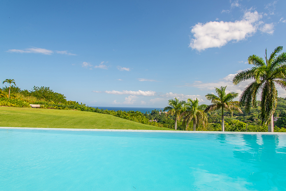 ... then cast your eyes down to earth and gaze into the infinite blue sky and Caribbean horizon.