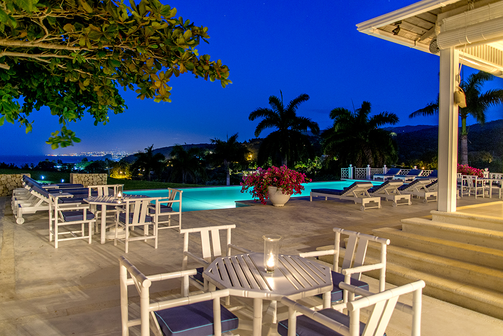 Solar light or candlelight, none compares to the 12-mile view across the Bay to the sparkling night lights of town from poolside chaises ...