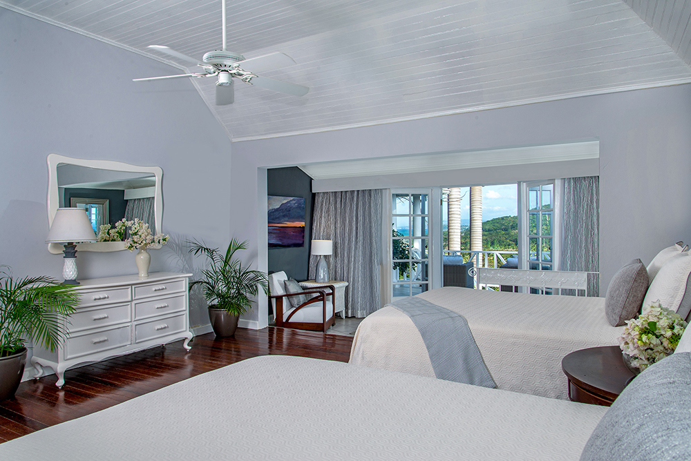 ACCOMMODATIONS One bedroom has two double beds for children or adults.  The en suite bathroom has a tub/shower combination.  Doors open to the gated balcony.