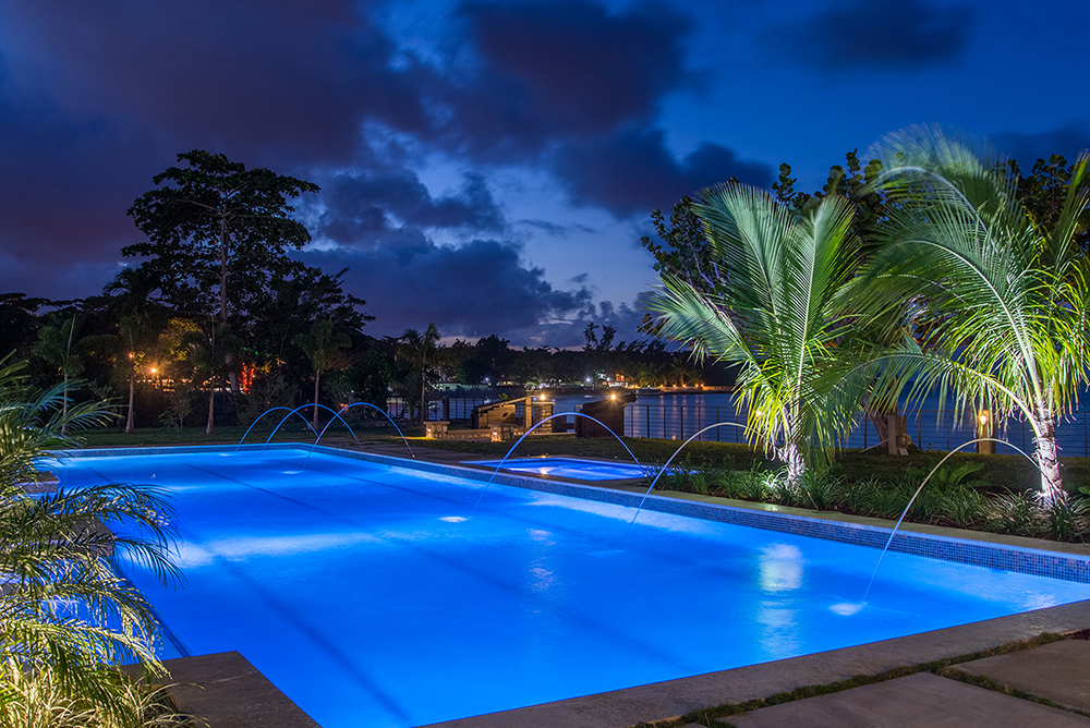 ... like the now-visible twinkling lights of neighboring villas along the far beach.