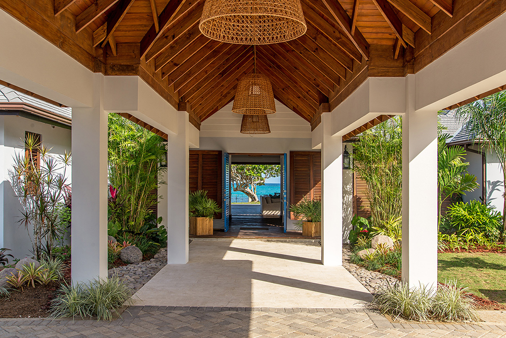 Step into this private staffed villa on beautiful Old Fort Bay.