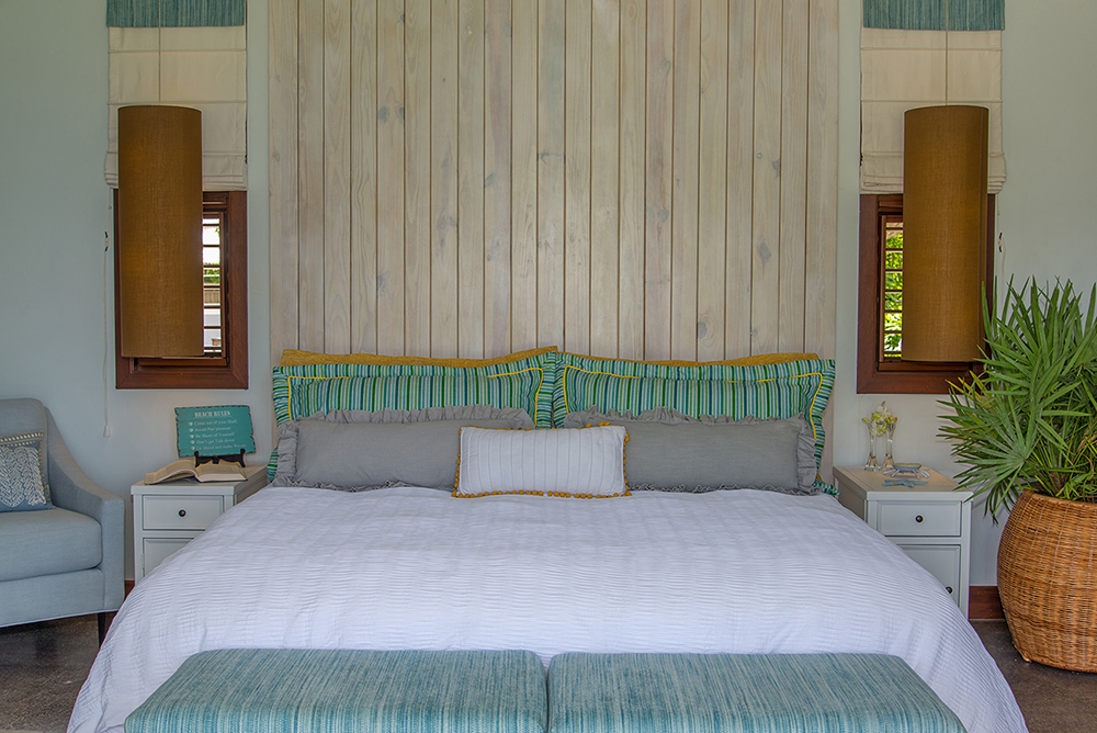 ACCOMMODATIONS Downstairs  Bedroom 1   King bed, driftwood headboard, poolside porch, bath with deep soaking tub ...