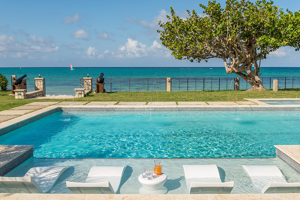 Or simply let sculpted pool chaises curl around you in shallow water sun shelves while you do nothing but survey the scene.