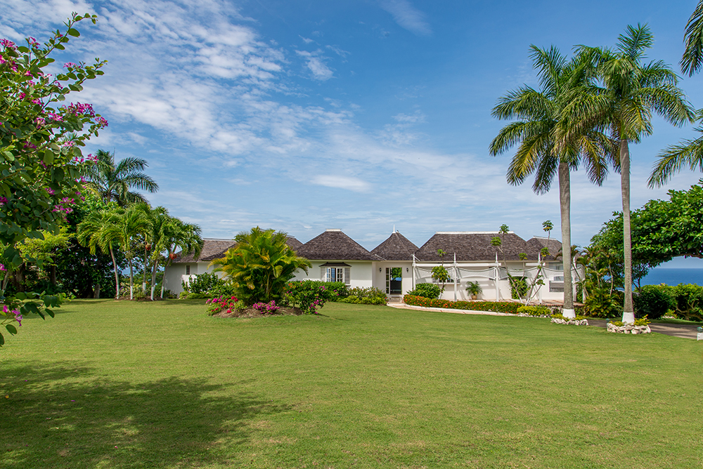 The large lawn behind the villa is wonderful for energetic youngsters.