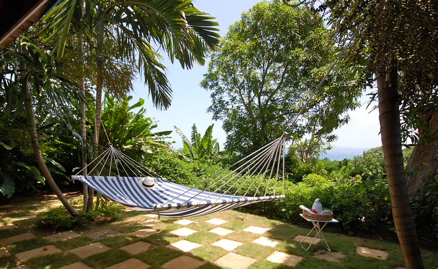 Bedrooms 2 and 3 open to a checkerboard terrace for hopscotch or swaying in the hammock.
