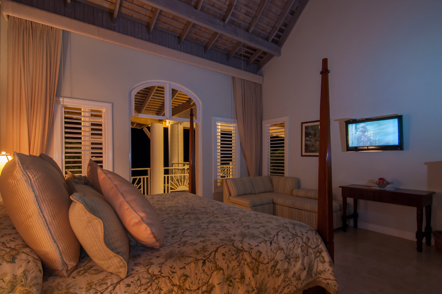 Each bedroom also opens through French doors to the long, furnished verandah.