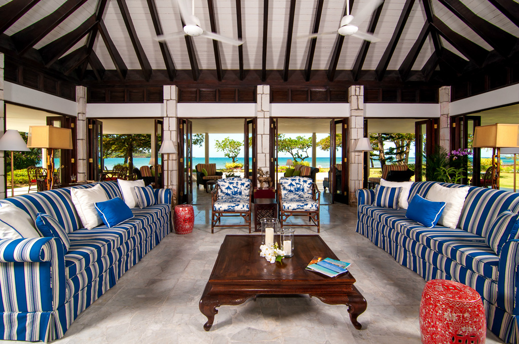 MAIN VILLA The Great Room is a 600-sq-ft pavilion with walls of glass doors on all four sides.  Floors of gleaming white Jamaican marble distinguish this central room and its wrap-around ver