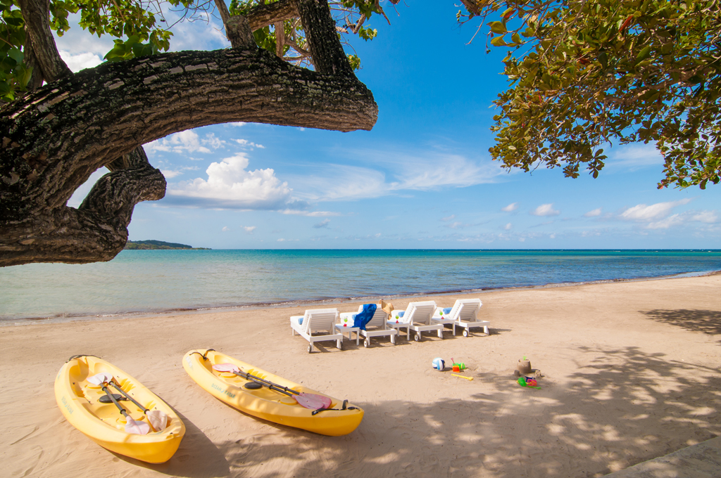 ... and a soft sand beach stocked with complimentary sea kayaks and vests for parents and kids.