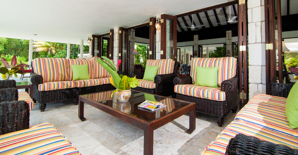 ... generously furnished with deep comfy chairs and sofas, dining tables, nearby bar and cable television.