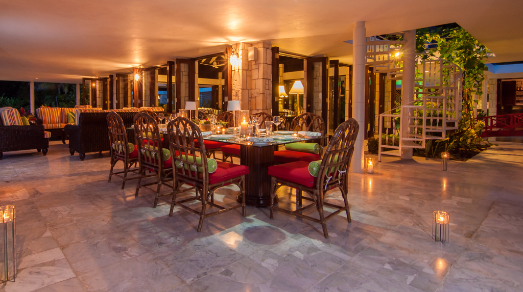On this spacious verandah, breakfasts, lunches and candlelight dinners are served ... memorable meals created by Chef Jerome and served by our good Butler Rodrick.