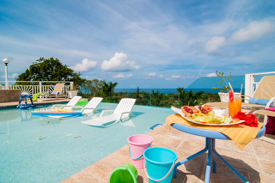 FAIRWAY MANOR IS CHILD FRIENDLY In addition air hockey, foosball, books, pool toys, movies and games for children at the villa ...