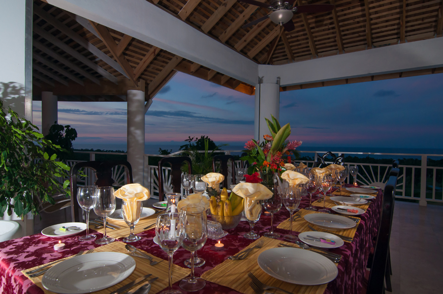 The 900-square-foot covered balcony, designed for its vast view, is the unanimous choice for marvelous meals created by Chef Charles and served by skillful butler Roy.