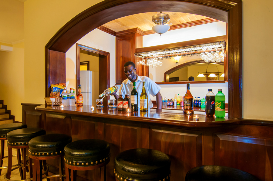 ... and a well-stocked bar manned by the congenial butler, Roy.