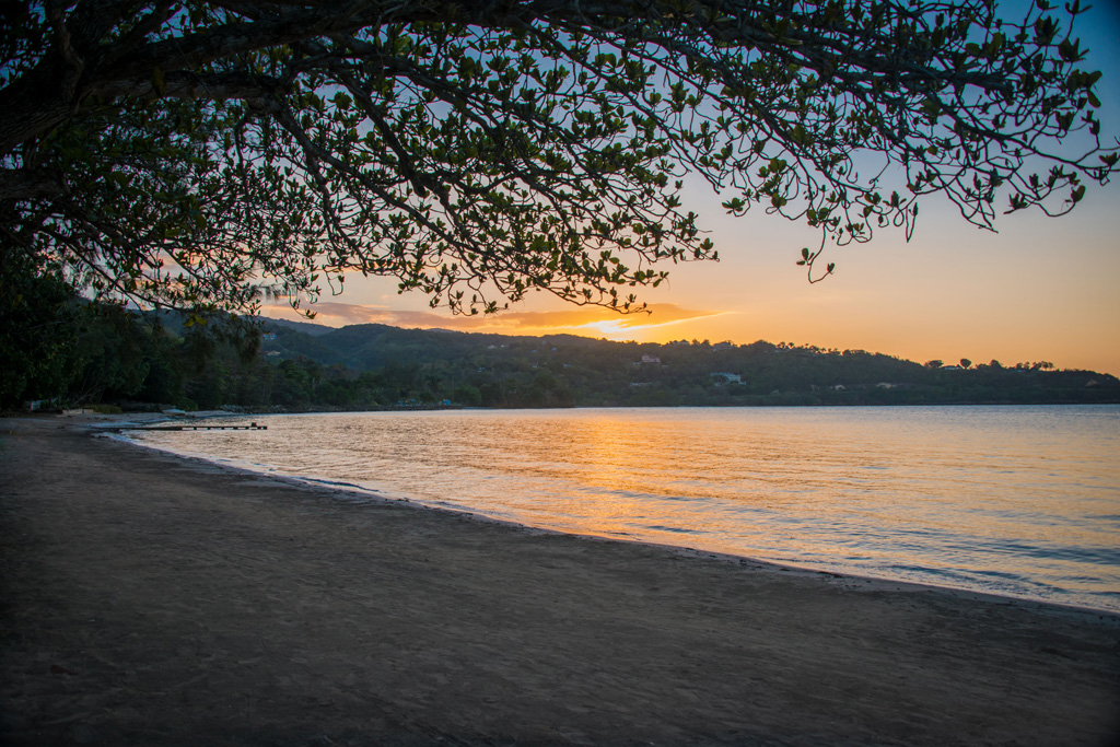 Walk west along the beach and linger on the soft sand through sunset (cameras recommended).