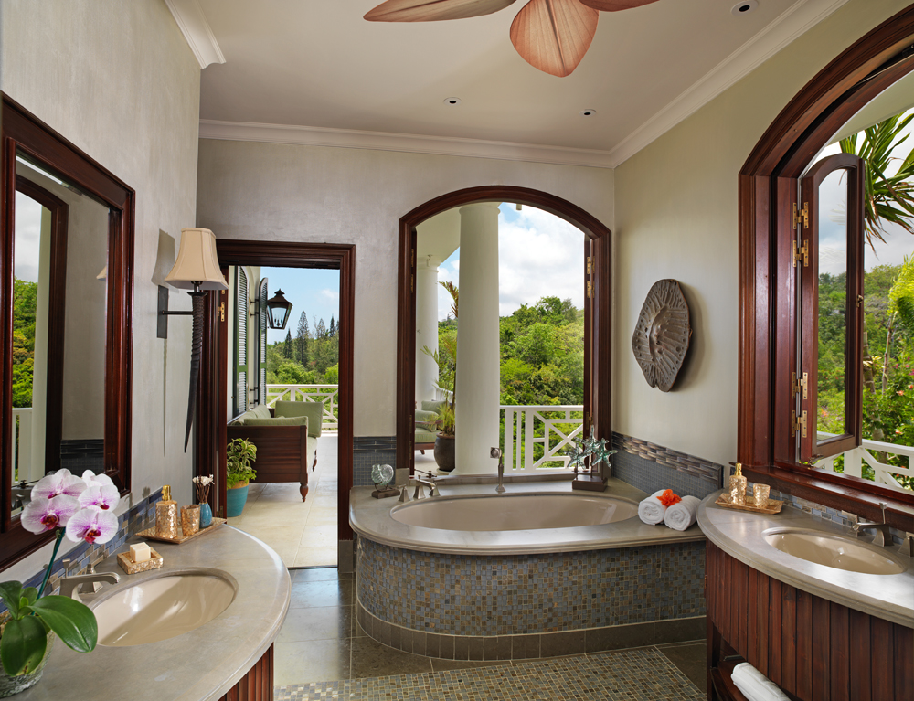 Its en-suite bathroom includes double stone vanities, bathtub and glass-door walk-in shower. The bathroom opens to a very private south sitting area. Like all bedrooms, Fleur de Lys also open