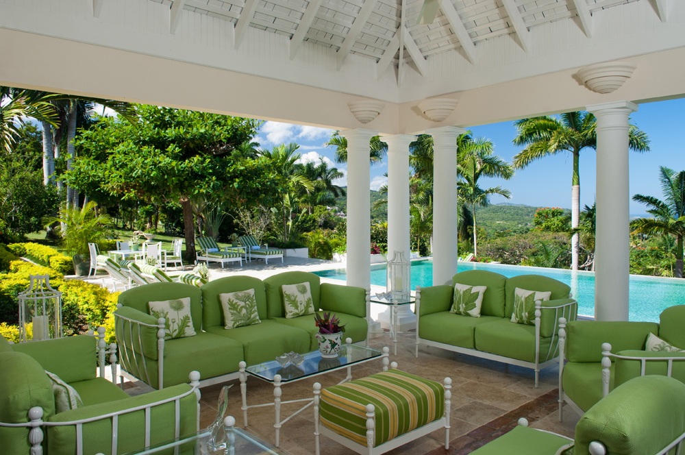 The covered terrace is furnished for comfort.