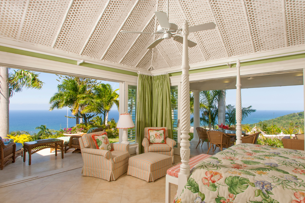 Bedroom 1 features a king size four-poster bed and is wrapped on two sides by its own furnished verandah .