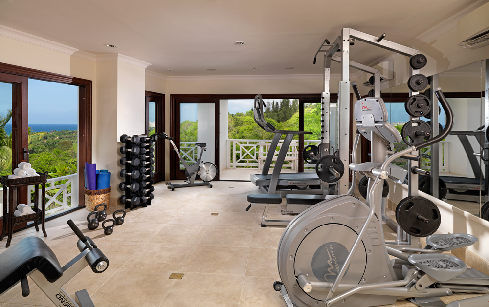 To stay in shape given the marvelous meals prepared by your personal chef ... wander through the downstairs corridor to the air-conditioned gym. Work out on the incliner trainer treadmill, do