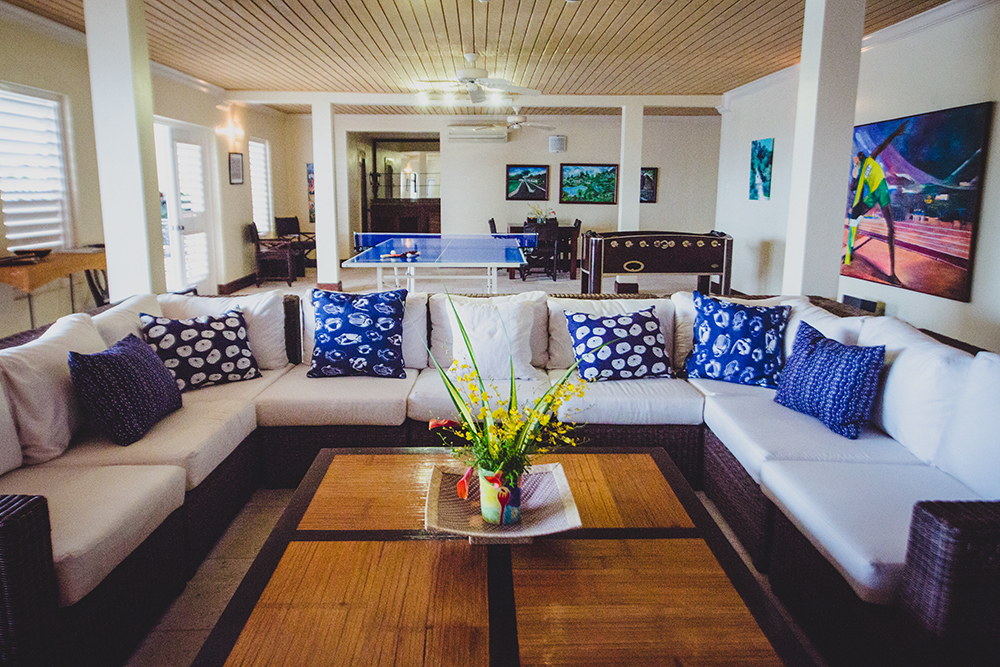 Also on the pool level is the playful Family Room with ping pong, foosball, games table and television.