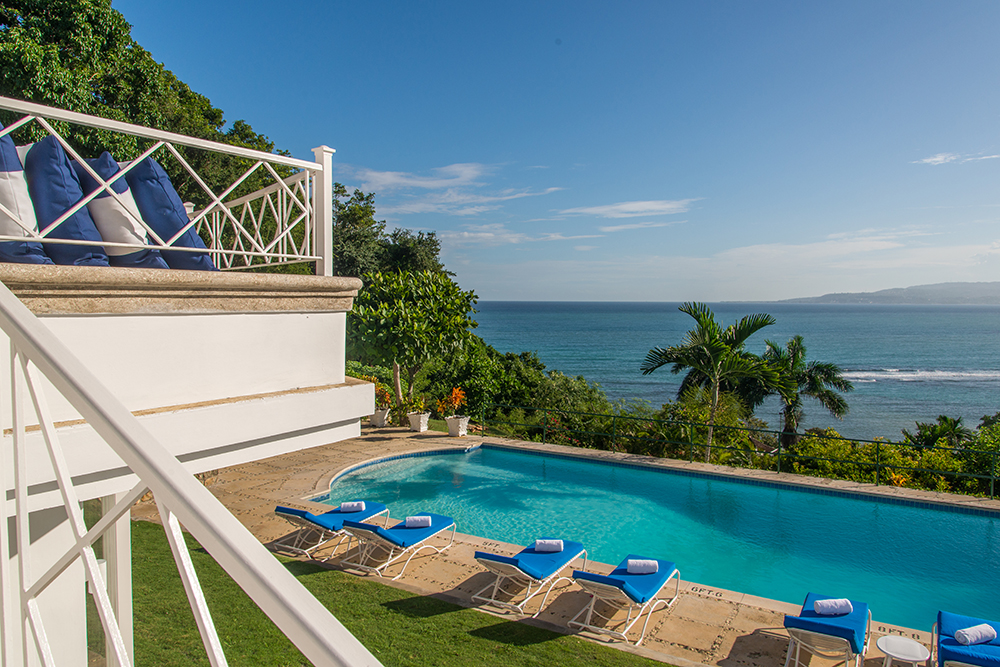 ... it joins a dramatic cushioned promontory  overlooking the pool in all-day sun.