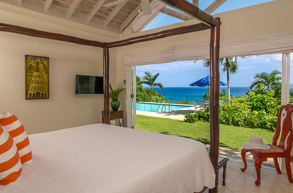 Like the Master, this four-poster bamboo bedroom offers an infinity view over Royal Palms to the horizon.