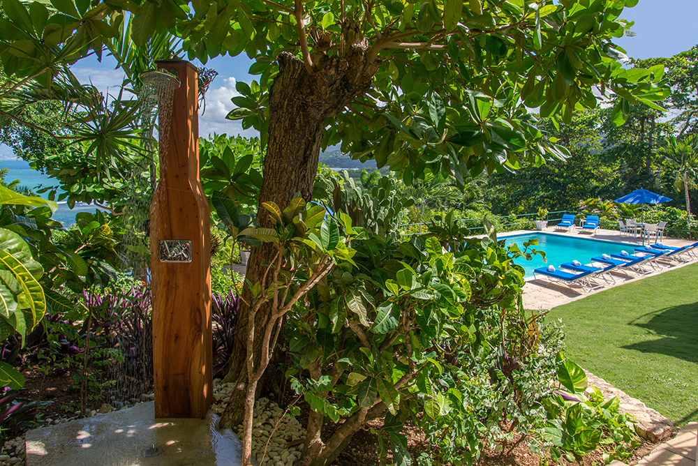 Nearby is the woodsy outdoor shower.