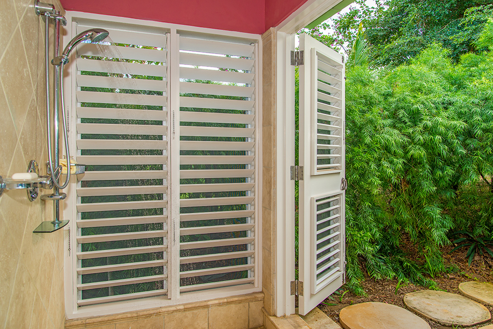 ...and walk-in shower that opens to a small private garden.
