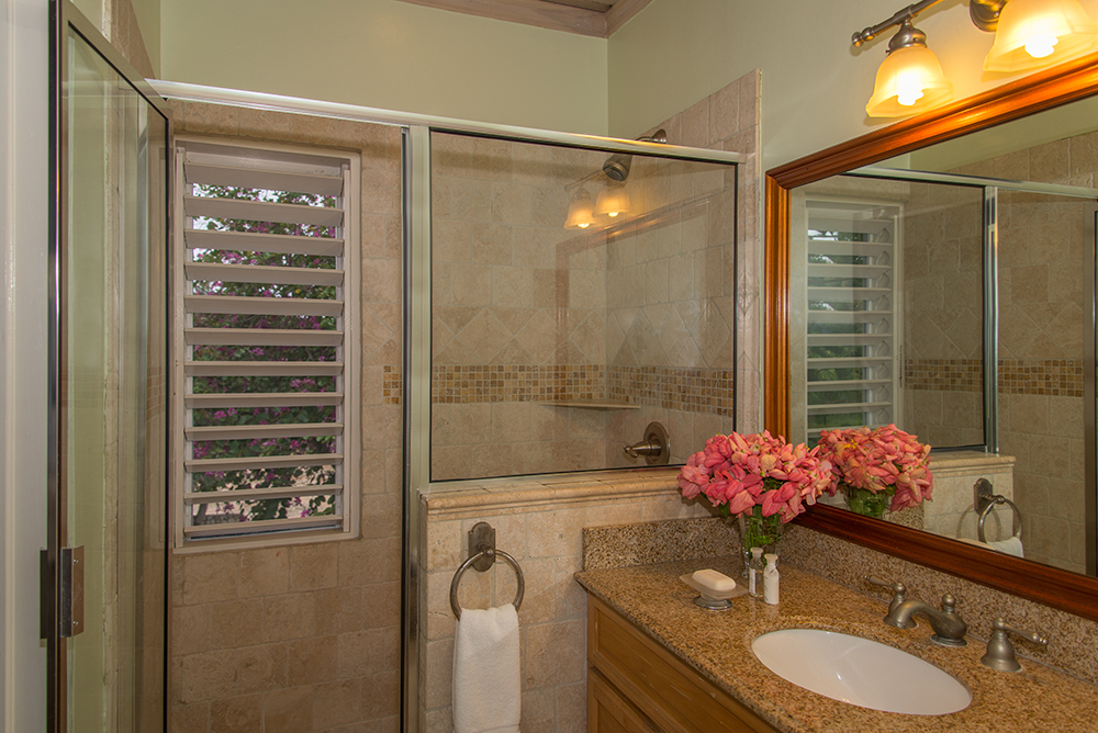 Bedrooms 3 and 4 have en-suite private bathrooms with walk-in showers tiled in Travertine.