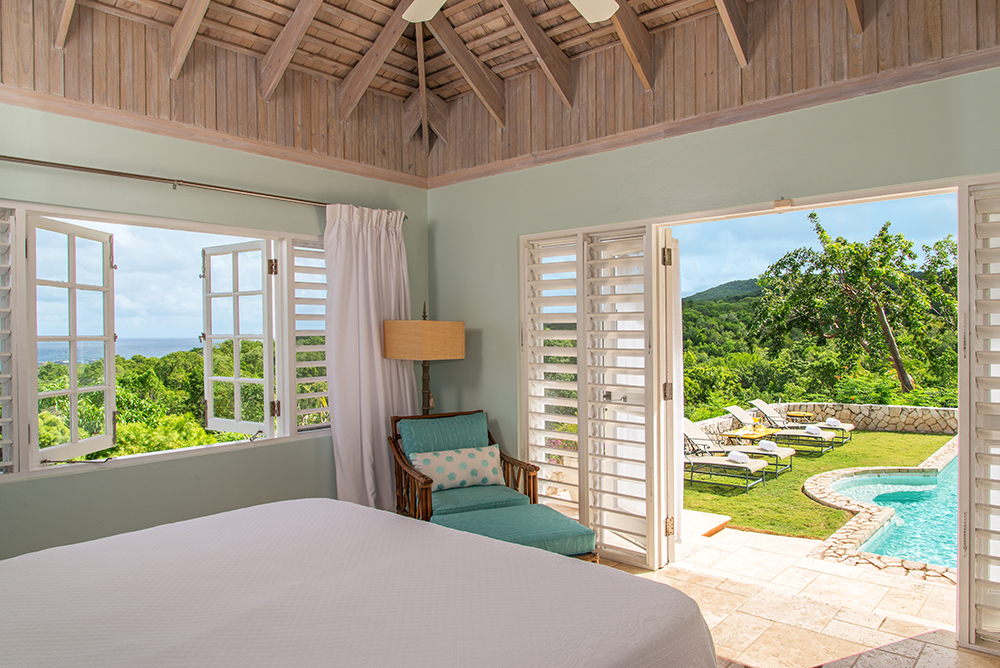 Bedroom 4 is poolside.  It has a king bed and lovely sea view.