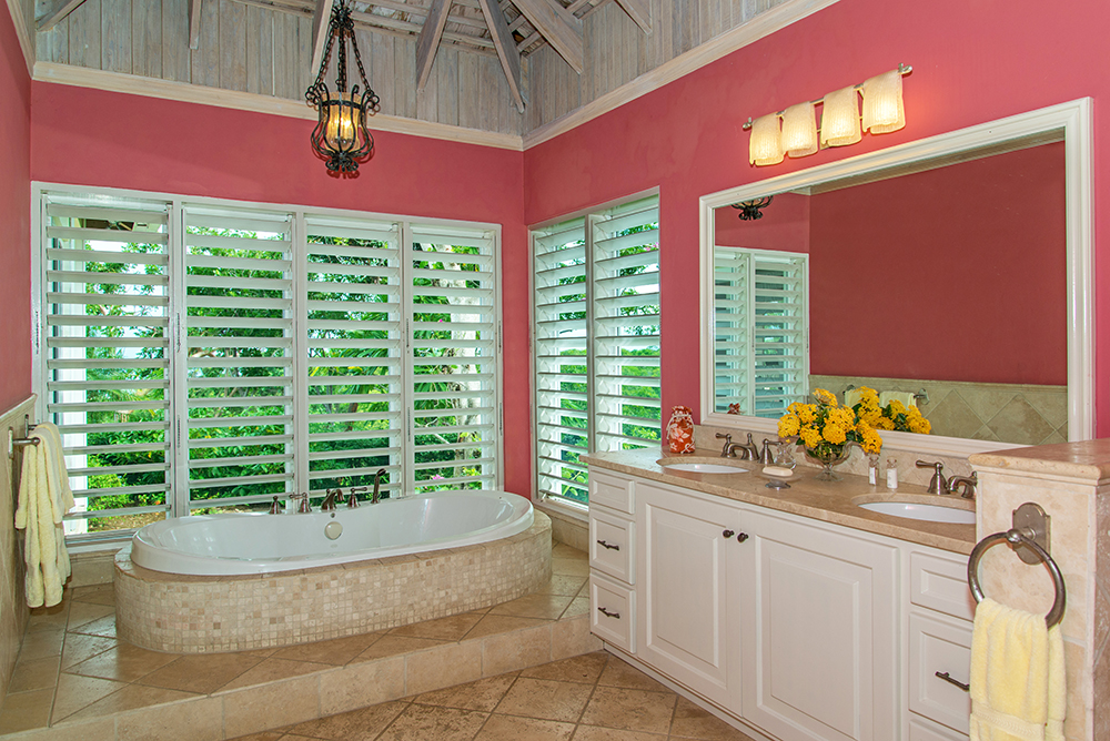 ... share the large master bathroom with  double sinks, Jacuzzi tub ...