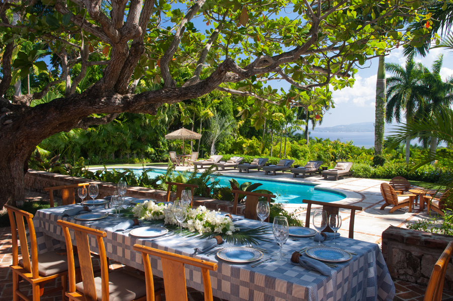 Most meals are served in the shade of the century-old tree by the side of the pool with
