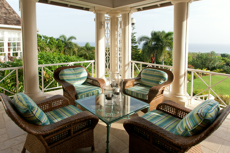 At the main house, the columned verandah is shaded and comfortable ...