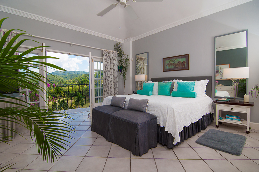 From the kingsize bed, French doors open to the iconic view of manicured golf course, blue-green mountains and the infinite blue Caribbean beyond.