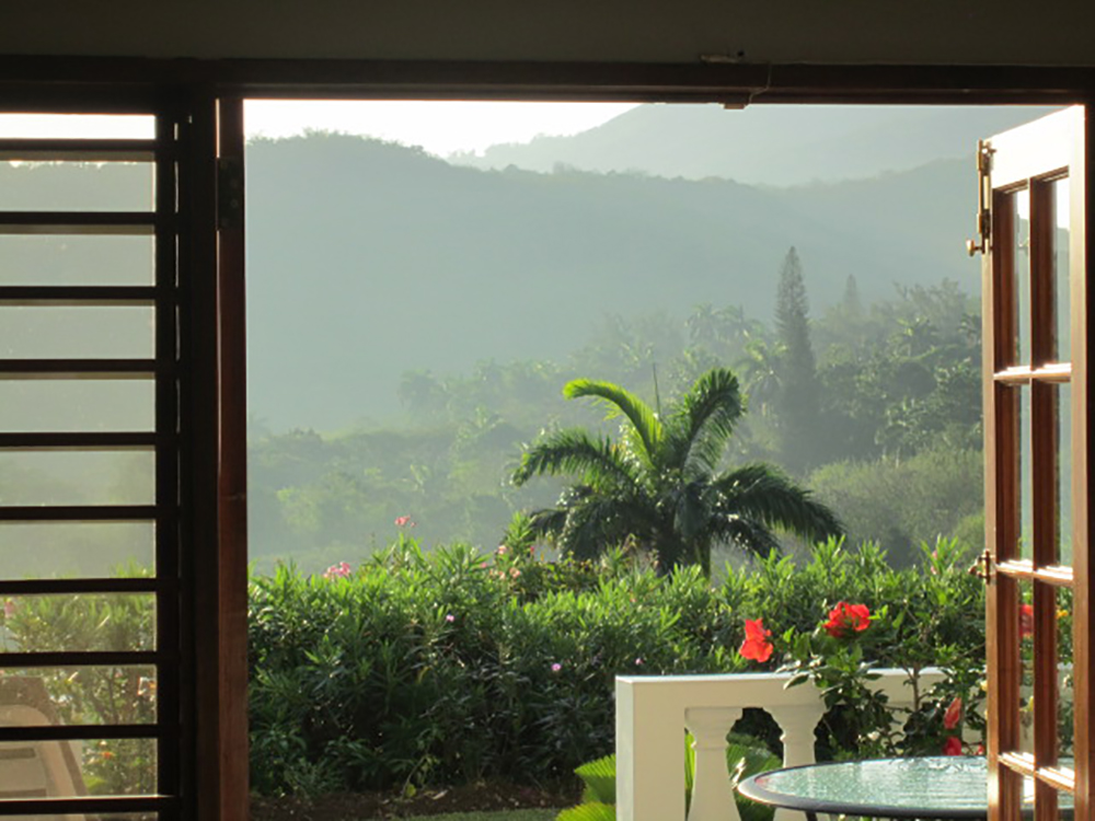 Walk downstairs for your first cup of Jamaican coffee, then pause to see the early misty morning magic of Mirador.