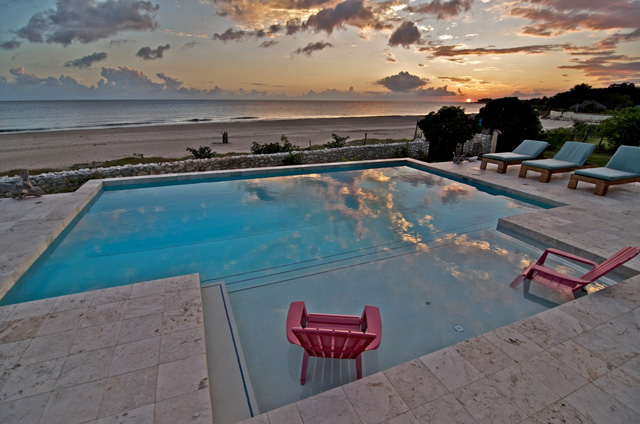 ... and a great big pool that has to be absolutely, positively on the beach?  Got it!